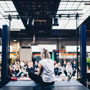 Yoga and wellbeing teacher teaching class